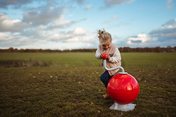 MusicBall child dancing in an open field